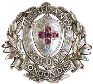 Silver replica of the Column's badge