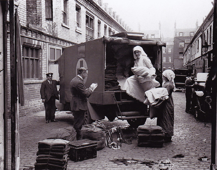 Loading up the blanket bus in Gower Mews.  Mr Peel with book.
